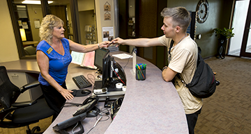 Student receiving support in student services