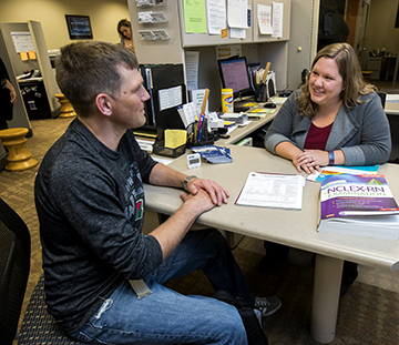 A WITC student receiving academic support from a WITC employee