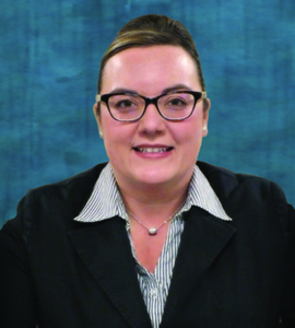 Head shot image of Foundation Board member Shay Horton wearing a black suit coat and glasses