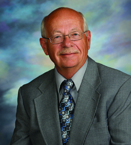 Head shot image of Foundation Board Treasurer Steve Leino wearing a suit and tie.