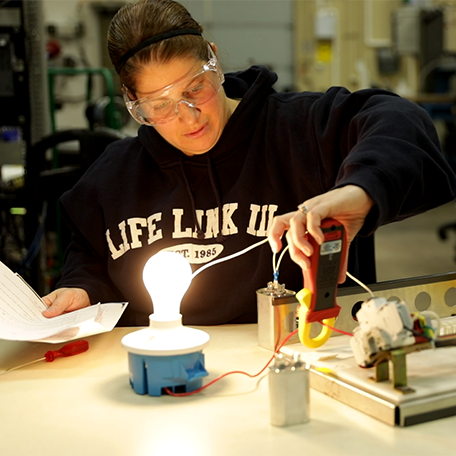 Student working with equipment in the automation lab