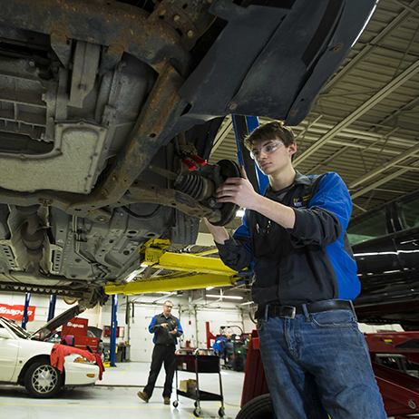Automotive student working the campus lab