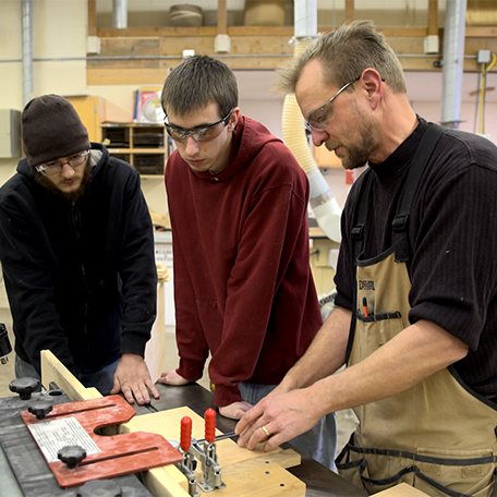An instructor showing students how to use the tools of the trade