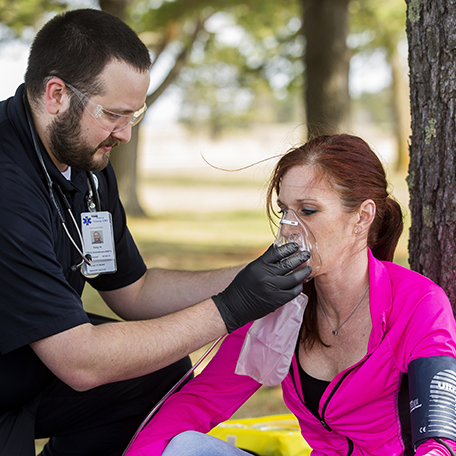 An EMT-Paramedic student practicing skills on a person