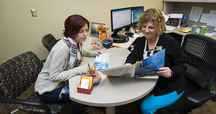 An admissions advisor assisting a student