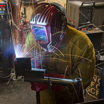 A student practicing welding skills