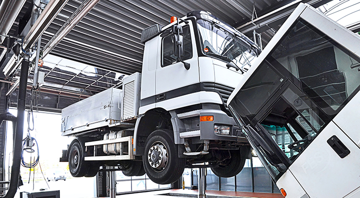 A diesel truck on a lift in a clean shop
