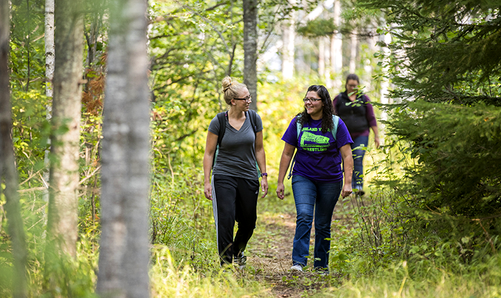 WITC students walking down a forested trail