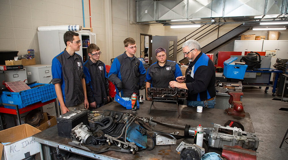 Automotive students listening to instructor in the shop