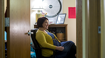 A counselor sitting in an office chair