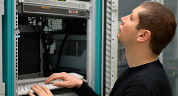 A systems administrator performing preventative maintenance