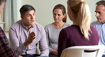 Members of a support group having a meeting