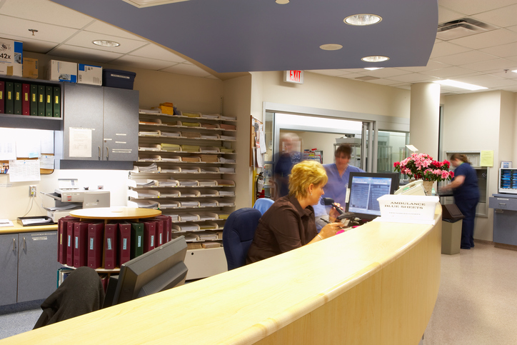 The receptionists desk at a busy hospital
