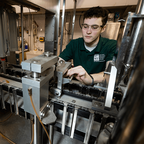 A student doing hands-on work in the automated packaging systems technician program