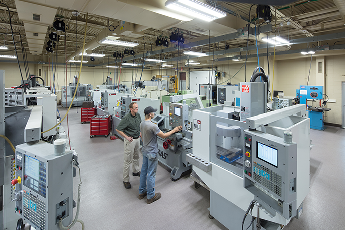 A view of the new machine tool lab and a student using one of the cnc machines