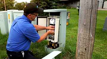 Broadband employee working in a residential neighborhood