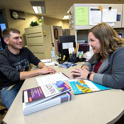 A student receiving support in student services