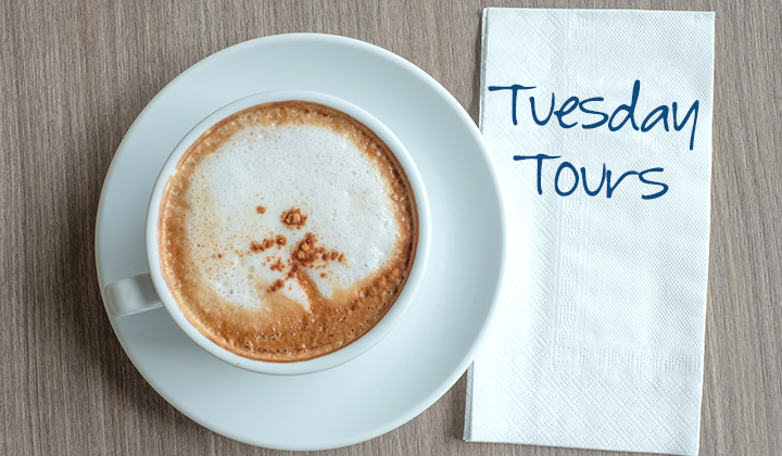Picture of a coffee and a napkin that says Tuesday Tours