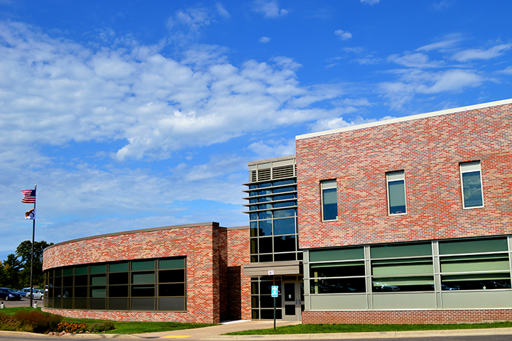 Outside view of the Rice Lake campus on a sunny day