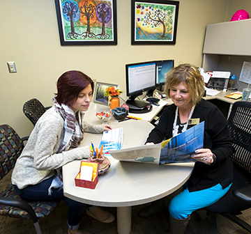 Student and WITC advisor sitting in an office at a table