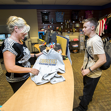 WITC student purchasing a WITC shirt in the bookstore