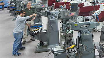 Students learning on machinery
