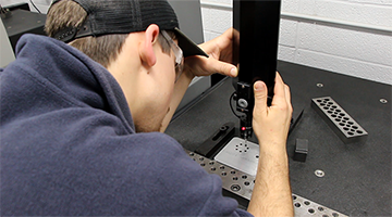 A student doing precision machinery work
