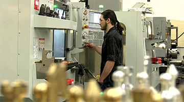 A student working with a cnc machine in the lab