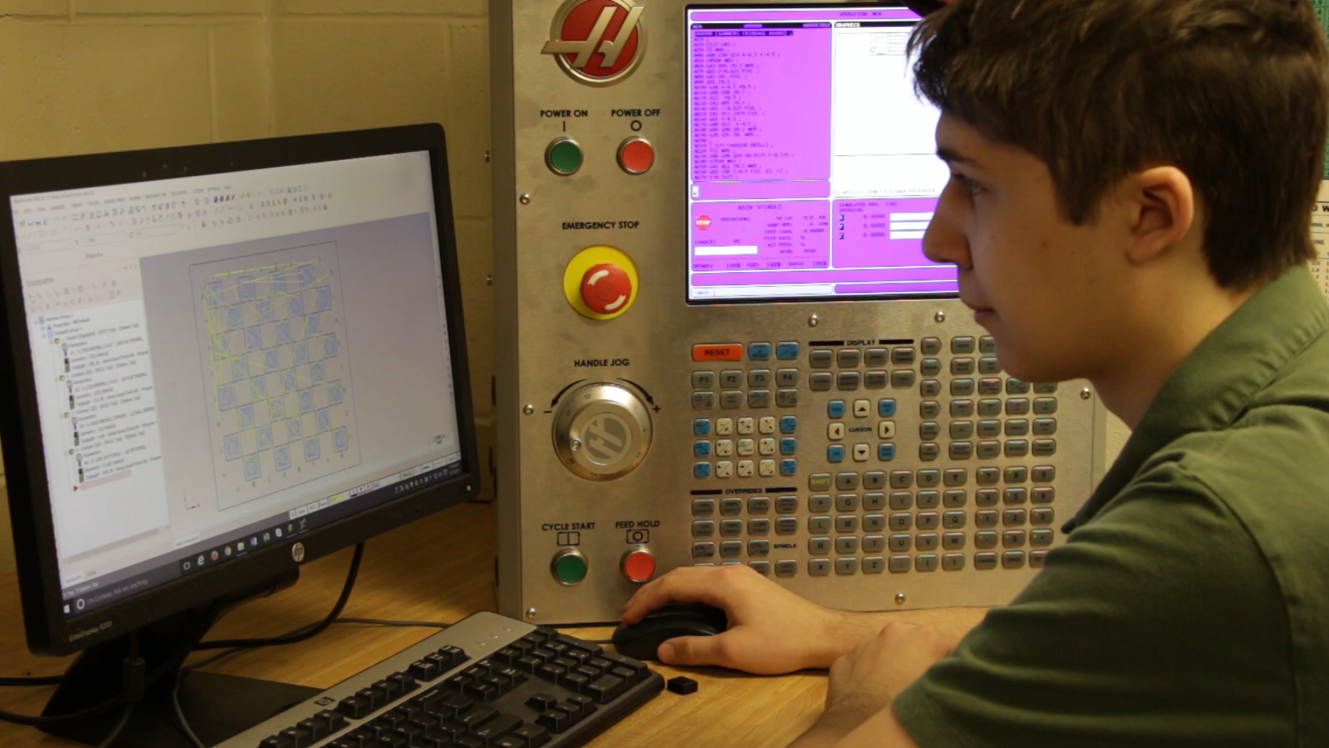 A student drafting their design on a computer