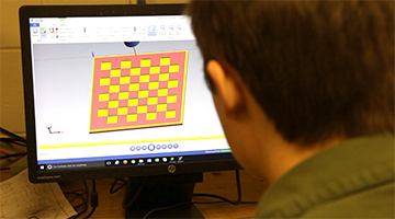 A student creating a design on the computer