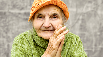 Close up of an aging adult looking into the camera