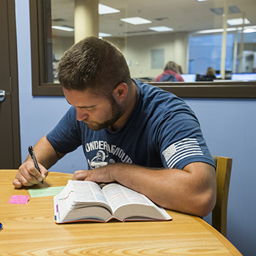 Student studying from a book