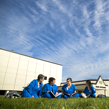 Group of nursing students studying in the lawn of the WITC-Superior campus