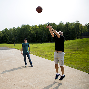 WITC Campus Administrator playing basketball with a student