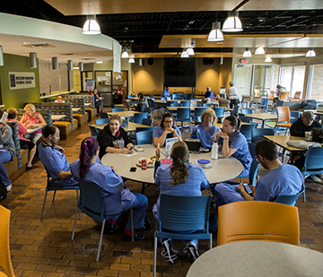 Image of the WITC-Ashland commons area with students sitting around