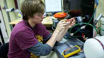 Student working on equipment in WITC's automation lab